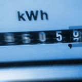 Expensive electricity. Electricity meter (blue background), increasing costs Royalty Free Stock Photo