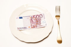 Expensive food. Concept - white plate and euro on it Royalty Free Stock Images