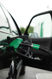 Expensive gas, fuel tanking. Image of filling fuel tank Royalty Free Stock Images