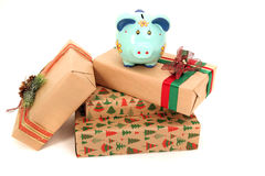Expensive gifts and piggy bank isolated Royalty Free Stock Image