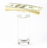 Expensive glass of water and dollars Stock Images