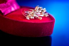 Expensive gold earrings in red box Stock Photography