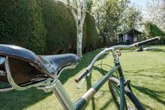 Close-up of a hand built path racer bicycle seen in a private garden. Royalty Free Stock Image