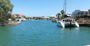 Expensive houses near the canals in Mandurah. Luxury houses and boats on the canals in Mandurah, Western Australia Stock Photography