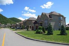 Expensive houses in suburbs. Expensive houses in a prestigious suburban neighborhood near the mountain Stock Photography