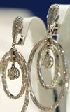 The expensive jewellery. The expensive silver earrings with diamonds Stock Image