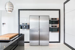 Expensive kitchen in modern house Royalty Free Stock Photos