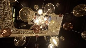 Expensive Large Chandelier Of Glass In A Restaurant Or Concert Hall. Chandelier Lighting In Hall, Bokeh, Glare, Glow stock video footage