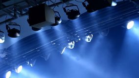 Expensive light equipment hanging above stage in a concert hall, performance. Stock footage stock video