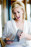 Expensive Meal. A young attractive woman is shocked at her restaurant bill stock photography