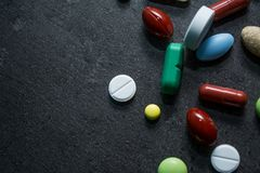 Medicines on a black background. Expensive medicine. Heart. Medicines on a black background Royalty Free Stock Photography