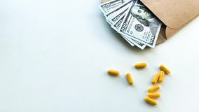 Expensive medicine. Pills of different colors and money on white table stock video footage