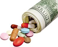 Expensive medicines. Currency medicine pill pill bottle dollar concepts aspirin Stock Photo