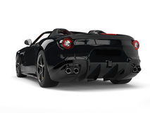 Expensive modern black sports car - back view Royalty Free Stock Photos