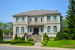 Expensive modern large white house. With huge windows in Montreal, Canada Royalty Free Stock Images
