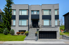 Expensive modern large white house. With huge windows in Montreal, Canada Royalty Free Stock Photography