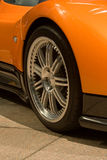 Expensive orange super car front tire Stock Photos