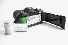 Expensive Photography 2. 35mm camera with money representing film. 2 rolls of 'money' film stock images
