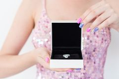 Expensive present holiday jewelry ring gift box. Expensive present for someone special. holiday celebration and beautiful jewelry concept. woman holding a stock photography