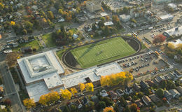 Expensive Private School in Urban Area. Aerial view of wealthy high school track, field and facility Royalty Free Stock Photos