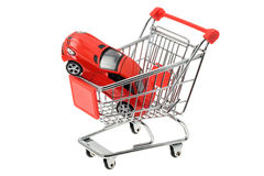 Expensive sports car in a shopping cart Stock Photos
