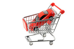 Expensive sports car in a shopping cart Stock Image