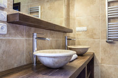 Expensive toilet with marble washbasin Stock Images