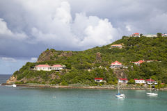 Expensive villas and boats at St. Jean Bay in St Barths. ST BARTHS, FRENCH WEST INDIES - NOVEMBER 5:Expensive villas and boats at St. Jean Bay on November 5 Stock Photography