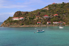 Expensive villas and boats at St. Jean Bay at St Barts. ST BARTS, FRENCH WEST INDIES - JUNE 11, 2015: Expensive villas and boats at St. Jean Bay at St Barts. The Stock Photo