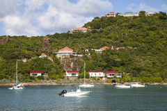 Expensive villas and boats at St. Jean Bay at St Barts, French West Indies Royalty Free Stock Image