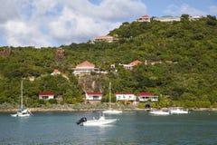 Expensive villas and boats at St. Jean Bay at St Barts, French West Indies. ST BARTS, FRENCH WEST INDIES - NOVEMBER 5: Expensive villas and boats at St. Jean Bay Royalty Free Stock Image