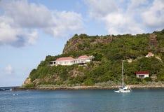 Expensive villas and boats at St. Jean Bay at St Barts, French West Indies. ST BARTS, FRENCH WEST INDIES - NOVEMBER 5: Expensive villas and boats at St. Jean Bay Royalty Free Stock Photography