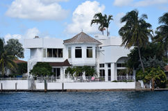 Expensive waterfront mansion Stock Images