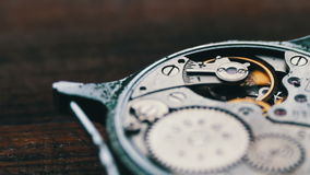 Expensive wrist watch mechanism in action, close up stock footage