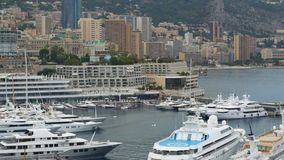 Expensive yacht with helipad docked in Monaco harbor, luxury private property stock video