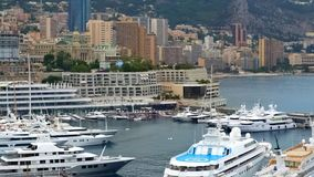 Expensive yacht with helipad docked in Monaco harbor, luxury private property. Stock photo stock photo