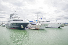 Expensive yachts stand on the dock at the yacht club. stock photo