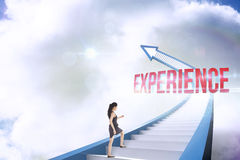 Experience against red staircase arrow pointing up against sky Royalty Free Stock Photography