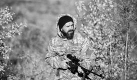Experience and practice lends success hunting. Hunting season. Harvest animals typically restricted. Guy hunting nature. Environment. Bearded hunter rifle royalty free stock photos