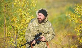 Experience and practice lends success hunting. Hunting season. Harvest animals typically restricted. Guy hunting nature. Environment. Bearded hunter rifle royalty free stock images