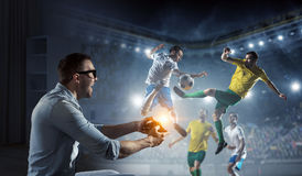 Experience the reality of game. Mixed media. Emotional guy wearing glasses playing gamepad. Mixed media Stock Photography