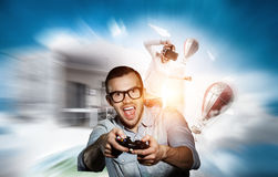Experience the reality of game. Mixed media Royalty Free Stock Photos