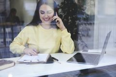 Experienced accountant calling to banking service paying online royalty free stock photo