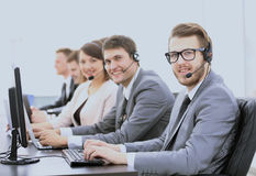 Experienced assistants with a headset in front of computers in t Stock Image