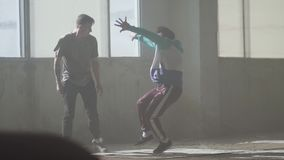 Experienced attrsctive hip-hop dancer performing. The man stretches his arms forward, then makes sharp movements to the. Portrait of young passionate hip-hop stock footage
