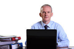 Experienced businessman at his desk Royalty Free Stock Image