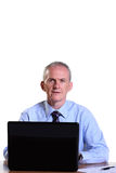 Experienced businessman at his desk with a laptop Royalty Free Stock Photo
