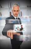 Experienced businessman using futuristic interface Royalty Free Stock Images
