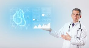 Cardiologist presenting the research results. Experienced cardiologist presenting the test results stock photo