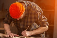 experienced carpenter work in workshop stock photography